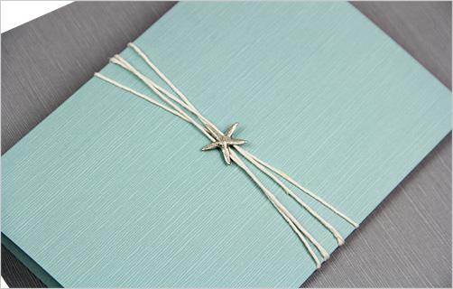 Seafoam blue folder invitation with starfish and twine embellishment