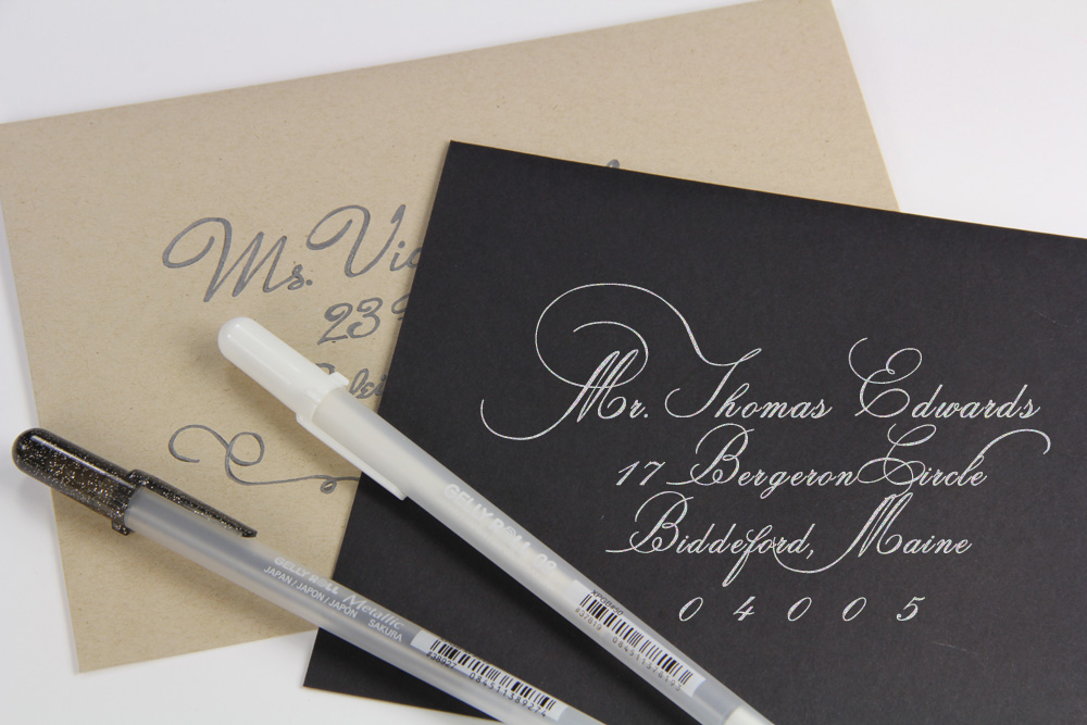 black and kraft envelopes addressed with calligraphy