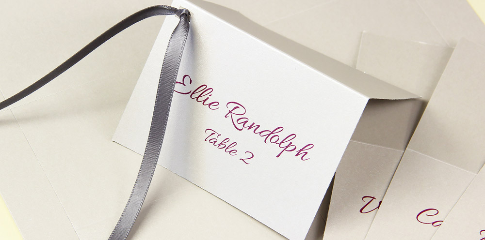Embellish metallic finish place cards with ribbon