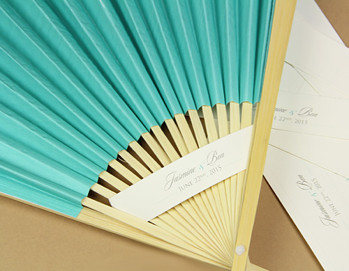 fan threaded with personalized paper band