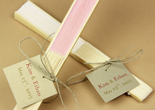 wedding fans decorated with twine and personalized tags