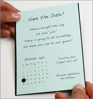 hole punched calendar save the date