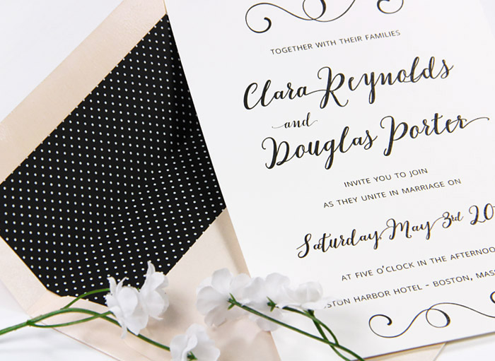 Simple black and white wedding invite with custom printed polka dot envelope liner from LCIPaper.com
