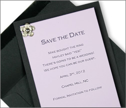 black and lilac layered save the date card with flower brad