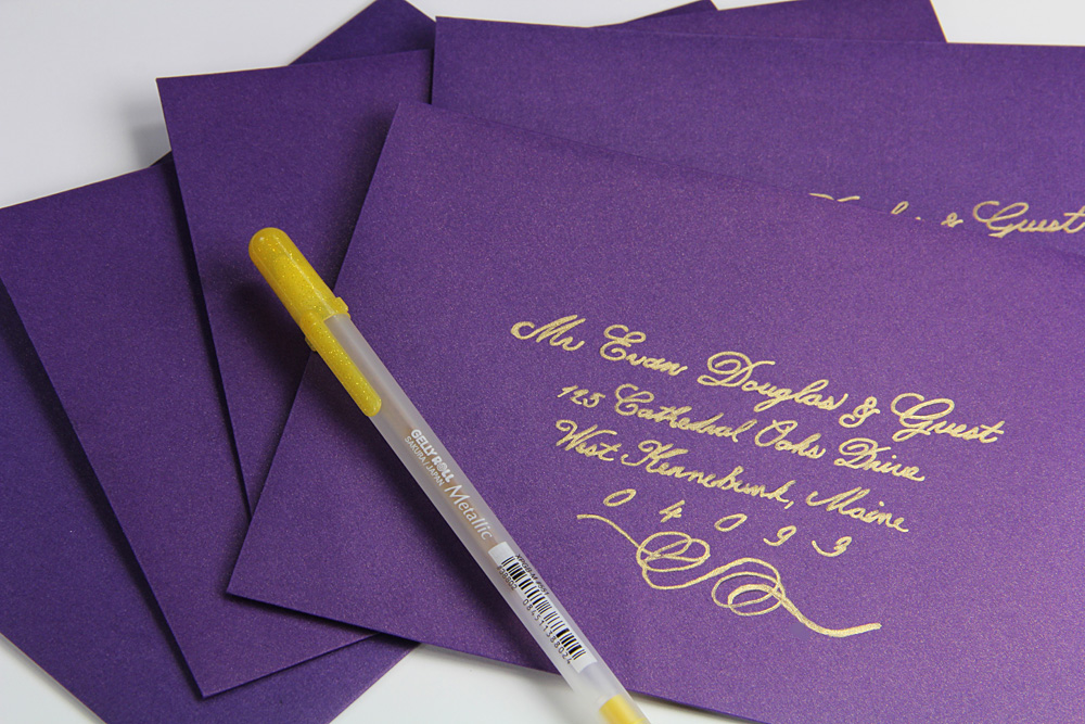 purple metallic envelopes addressed with gold ink