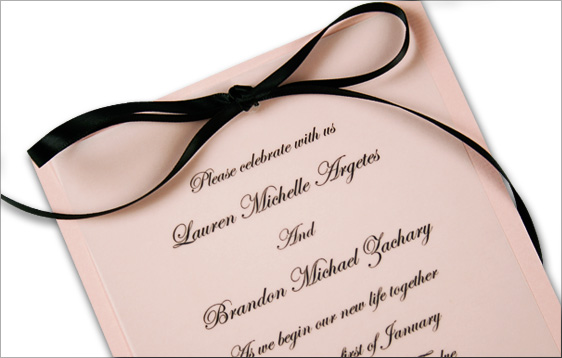 vellum adhered with black satin ribbon