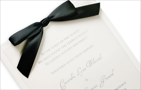 simple vellum invitation with black satin bow