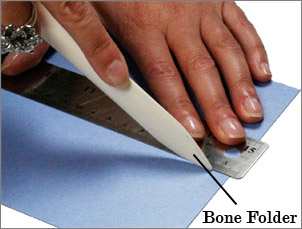 use a bone folder to score paper by hand