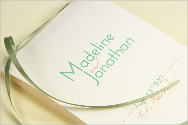 5x7 program with a 2 hole punched ribbon binding