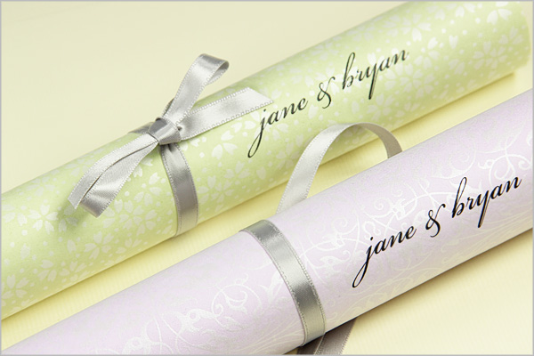 scroll programs made with pearlized paper tied with ribbon